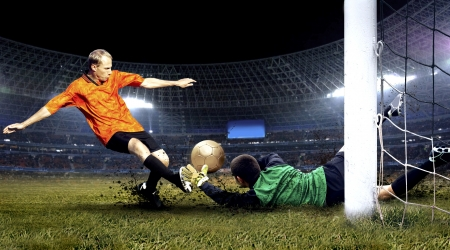 Photo pour Football player and jump of goalkeeper on the field of stadium at night - image libre de droit