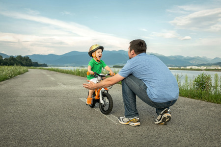 Photo pour Father and son on the bicycle outdoor - image libre de droit