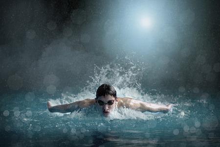 Photo pour Swimmer in open waterpool, swim one of swimming style - image libre de droit