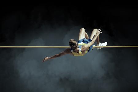 Foto de Athlete in action of high jump. - Imagen libre de derechos