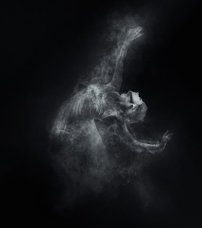 Photo for Dancer from smoke on the dark background - Royalty Free Image