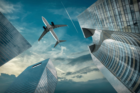 Photo pour Airlane flying over modern glass and steel office buildings near La Defence district in Paris, France. - image libre de droit