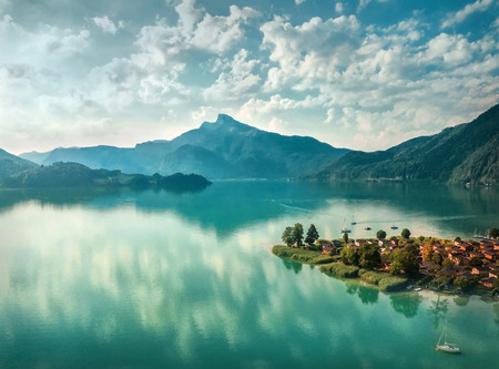 Photo pour Beautiful morning sunrise view on the mountain lake in Alps under sunlight in summer. Aerial photography from a bird's eye view. - image libre de droit