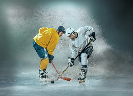 Photo for Caucassian ice hockey Players in dynamic action in a professional sport game play on the laptop in hockey under stadium lights. - Royalty Free Image