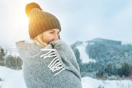 Foto de Portrait Happy woman traveler on the top of mountain and looking on beautiful winter snowy view. - Imagen libre de derechos