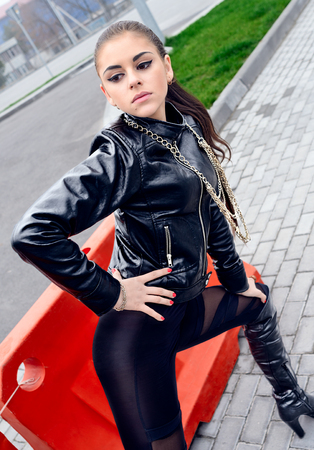 official supplier for whole family presenting Sexy brunette girl with black eyes. Young female model ...