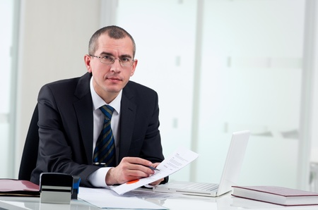 Lawyer or notary public on his workplace signing contract
