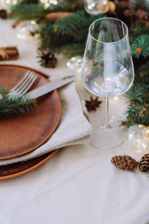 Foto de Table with Christmas decorations and green spruce branches - Imagen libre de derechos