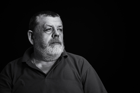 Nice black and white portrait of a thoughtful senior man