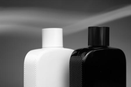 Perfume bottles on grey backgrond.