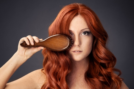 bright picture of beautiful woman with comb