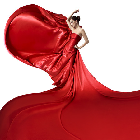Young beauty woman in fluttering red dress. Isolated on white background.