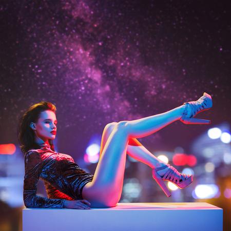 Photo for Beautiful fashion model posing. Night city at background. - Royalty Free Image