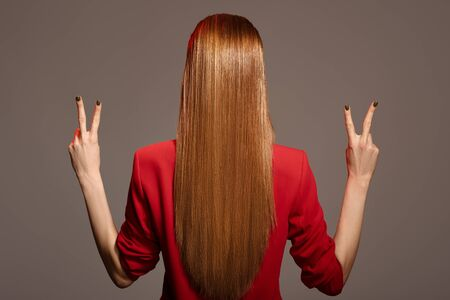 Foto de Rear view of beautiful woman with red long hair. - Imagen libre de derechos