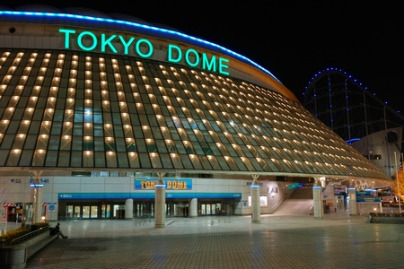 Tokyo, Japan - February 14, 2008: famous Tokyo Dome arena building in Korakuen district of Japanese capital with scenic evening illumination. Also Tokyo Dome is known as largest concert hall in Japan.