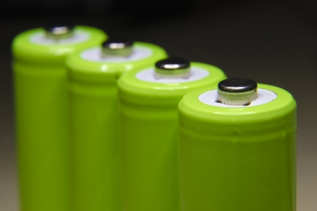 row of green rechargeable batteries with focus on front one