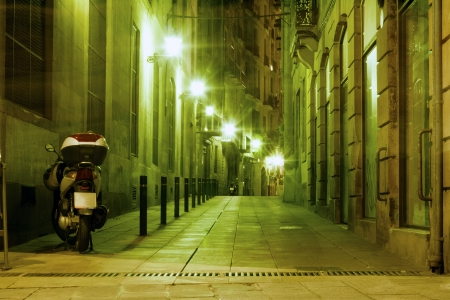 illuminated Barcelona night street in famous Gothic Quarter district