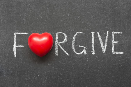 Photo for forgive word handwritten on chalkboard with heart symbol instead of O - Royalty Free Image