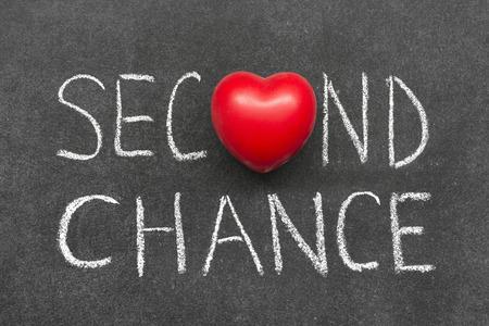 Photo pour second chance phrase handwritten on blackboard with heart symbol  - image libre de droit