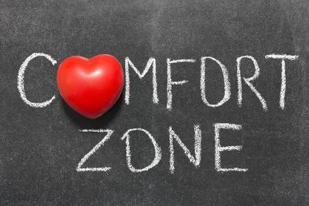 comfort zone phrase handwritten on blackboard with heart symbol instead of O
