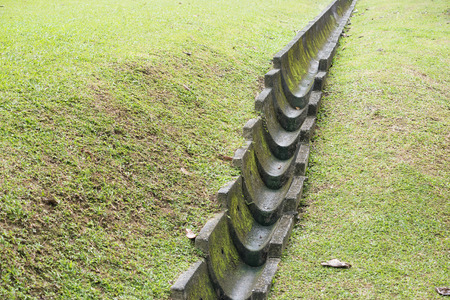 rainwater drainage channel on the green meadow in Singapore city