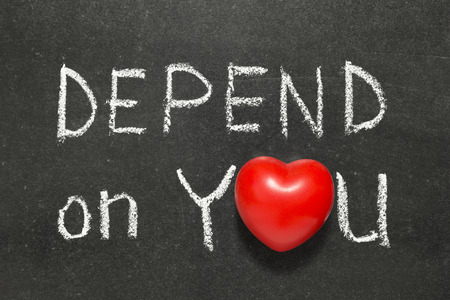 depend on you phrase phrase handwritten on blackboard with heart symbol instead of O