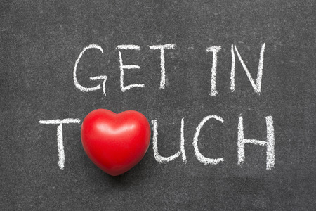 get in touch phrase handwritten on blackboard with heart symbol instead of O