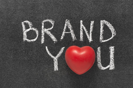 brand you phrase handwritten on blackboard with heart symbol instead of O