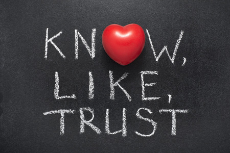 Photo for know,like,trust phrase handwritten on blackboard with heart symbol instead of O - Royalty Free Image
