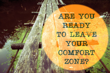 Photo for are you ready to leave your comfort zone question written on wooden rope bridge landscape - Royalty Free Image
