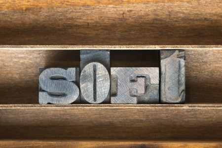 soft word made from vintage letterpress type on wooden tray