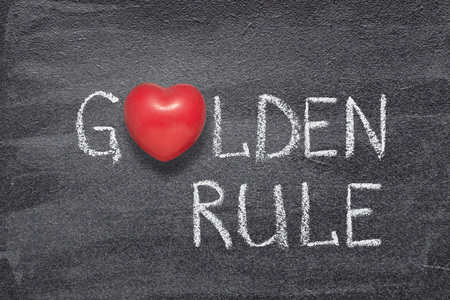 Foto per golden rule phrase handwritten on chalkboard with red heart symbol instead of O - Immagine Royalty Free