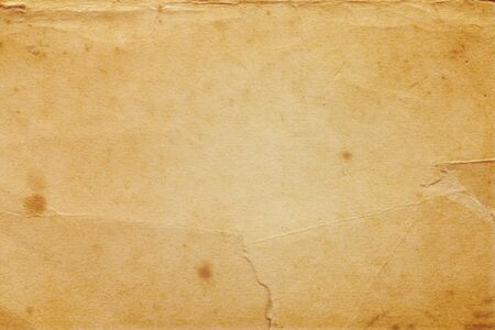 Foto per detailed yellowish vintage paper texture with many dents and scratches - Immagine Royalty Free