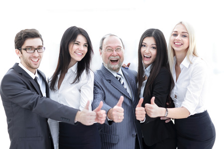 Foto de closeup head and business team showing thumb up. - Imagen libre de derechos