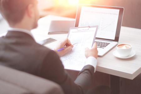 Photo pour closeup.businessman checking financial documents sitting at the Desk in the office. - image libre de droit