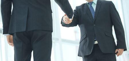 Photo for Closeup of handshake of two entrepreneurs wearing business suit - Royalty Free Image
