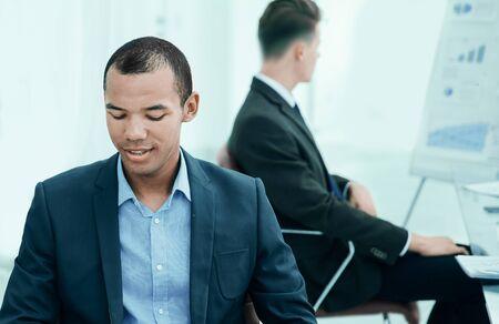 Photo pour promising young employee sitting behind a Desk - image libre de droit
