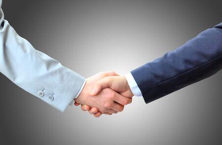 Photo pour Business people shaking hands, finishing up a meeting - image libre de droit