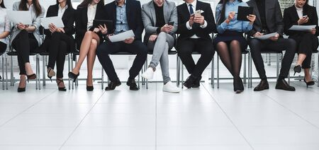 Foto de group of business people use their gadgets before starting a business meeting - Imagen libre de derechos