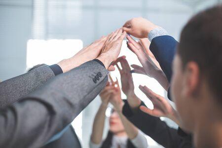 Foto de close up. a group of employees joining their palms - Imagen libre de derechos