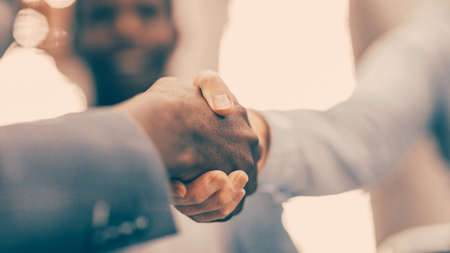 Photo for close up. blurry image of business people shaking hands. - Royalty Free Image