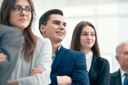 Photo pour close up. group of serious young entrepreneurs looking forward - image libre de droit