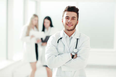 Photo pour successful pediatrician standing in the hallway of the medical - image libre de droit