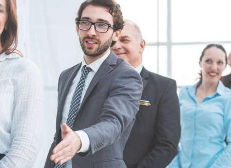 Foto de close up. young entrepreneur holding out his hand for a handshake - Imagen libre de derechos