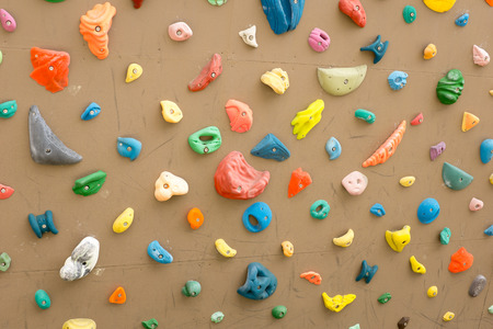 climbing wall with colorful footholds