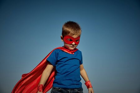 Photo for Funny little power super hero child (boy) in a red raincoat. Superhero concept - Royalty Free Image