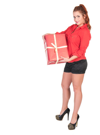 sexy woman in red shirt and black shorts posing with gift box.