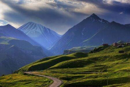 Foto de Mountain landscape at sunset time, with the rays of the sun. - Imagen libre de derechos