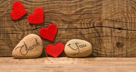Photo for Appreciate carved on decorative stones with red hears on wooden background - Royalty Free Image
