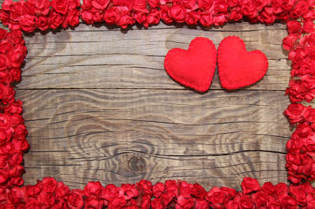 Photo for Two felt hearts with flower frame on wooden background - Royalty Free Image